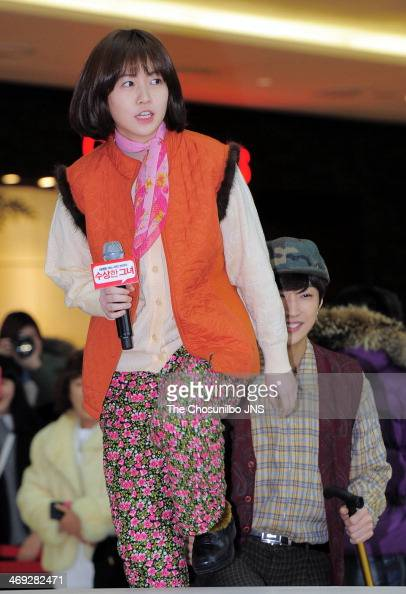 Sim EunKyung and JinYoung of B1A4 attend the movie 'Miss Granny' free hug event at Times Square on February 13 2014 in Seoul South Korea