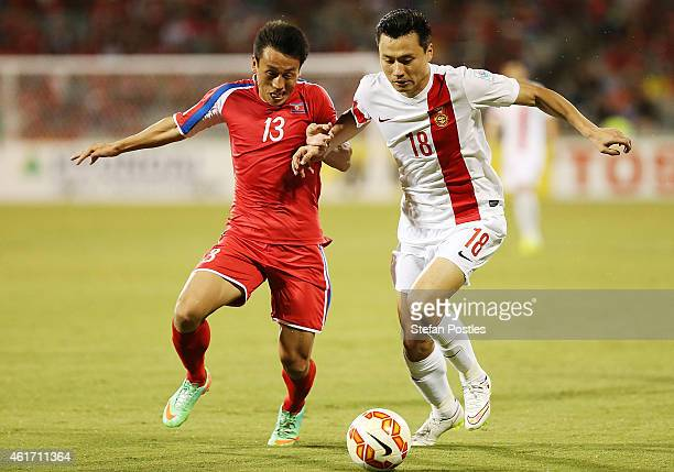 Sim Hyon Jin of DPR Korea and Gao Lin of China contest possession during the 2015 Asian Cup match between China PR and DPR Korea at Canberra Stadium...