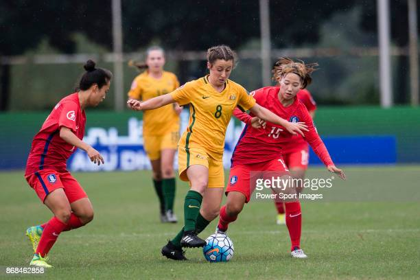 Sim Seohui of South Korea in action against Clare Wheeler of Australia during their AFC U19 Women's Championship 2017 Group Stage B match between...
