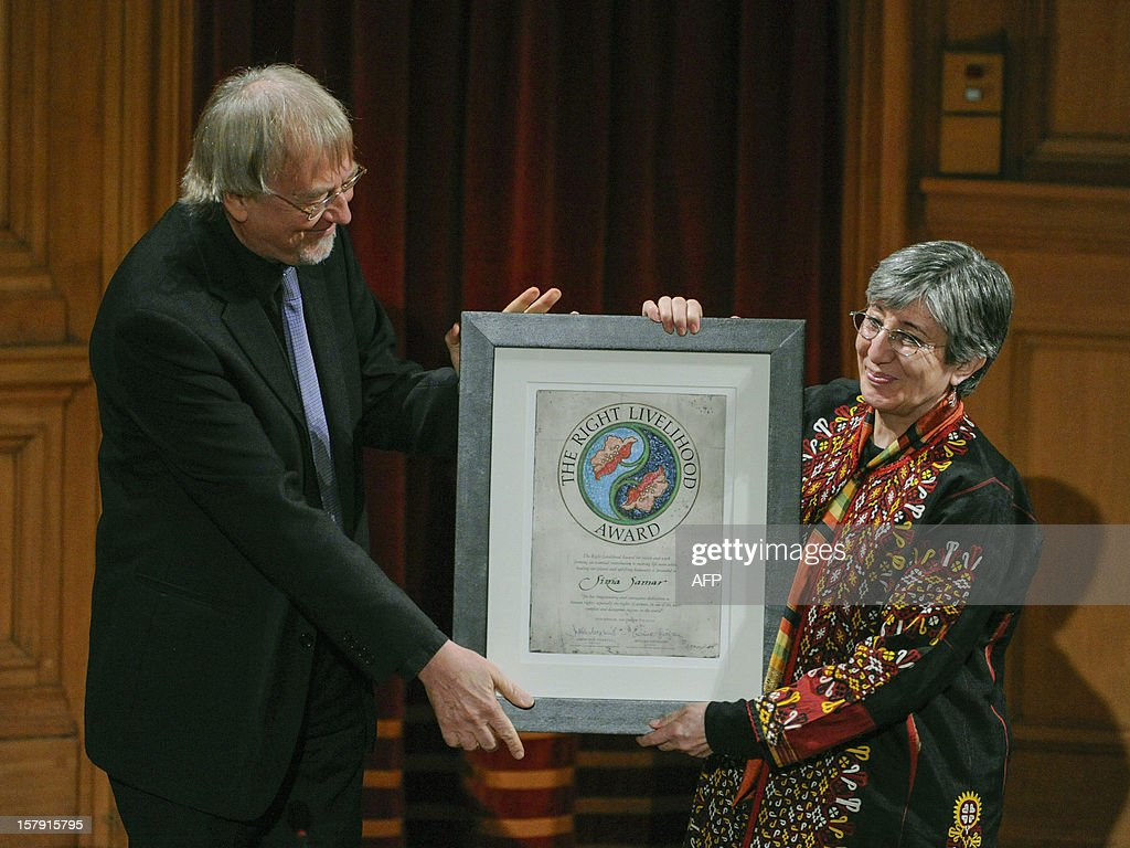 Sima Samar (R), of Afghanistan receive the Right Livelihood Prize from the founder Jacob von Uexkull (L) during a ceremony at the Swedish Parliament in Stockholm on December 7, 2012. AFP PHOTO / SCANPIX SWEDEN / ERIK MARTENSSON SWEDEN OUT