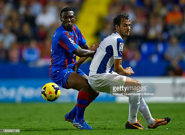 Simao Mate of Levante competes for the ball with Stuani of Espanyol during the La Liga match between Levante UD and RCD Espanyol at Estadio Ciutat de...