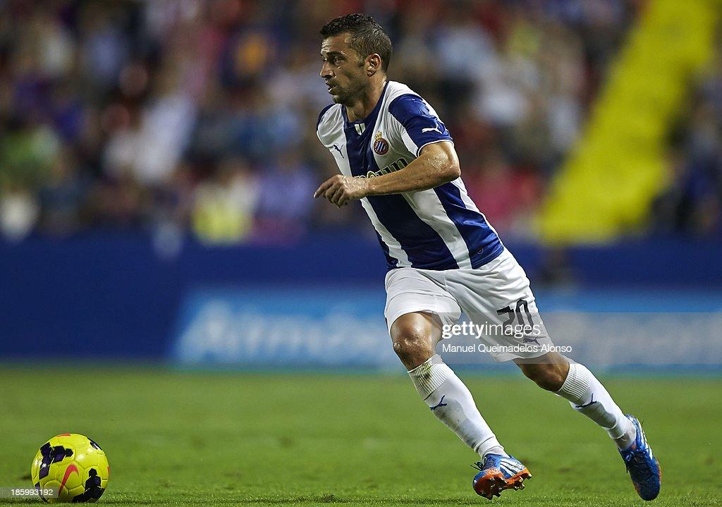 Simao of Espanyol runs with the ball during the La Liga match between Levante UD and RCD Espanyol at Estadio Ciutat de Valencia on October 26, 2013 in Valencia, Spain