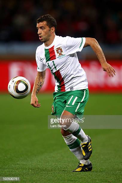 Simao of Portugal runs with the ball during the 2010 FIFA World Cup South Africa Round of Sixteen match between Spain and Portugal at Green Point...