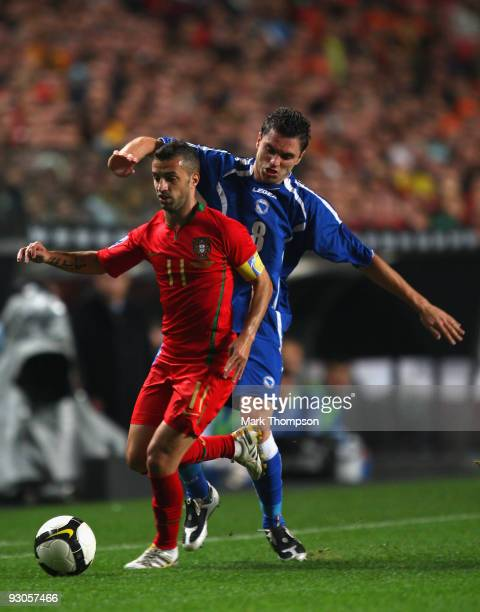 Simao Sabrosa of Portugal tangles with Sanel Jahic of Bosnia during the FIFA 2010 European World Cup qualifier first leg match between Portugal and...