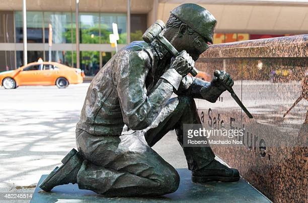 The Anonymity of prevention bronze statue showing a worker working with a chisel and hammer with safety goggles This bronze sculpture by artists...