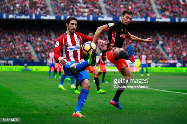 Sime Vrsaljko of Atletico de Madrid competes for the ball with Munir El Haddadi of Valencia CF during the La Liga match between Club Atletico de...