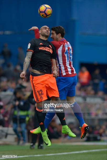 Sime Vrsaljko of Atletico de Madrid fights for the ball with Simone Zaza of Valencia during the La Liga match between Atletico de Madrid and Valencia...