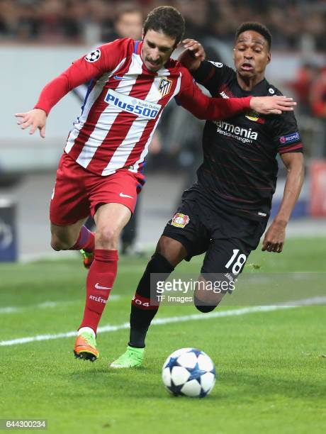 Sime Vrsaljko of Atletico Madrid and Wendell of Bayer Leverkusen battle for the ball during the UEFA Champions League Round of 16 first leg match...