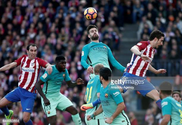 Sime Vrsaljko of Atletico Madrid in action against Gerard Pique of Barcelona during the La Liga football match between Atletico Madrid and Barcelona...