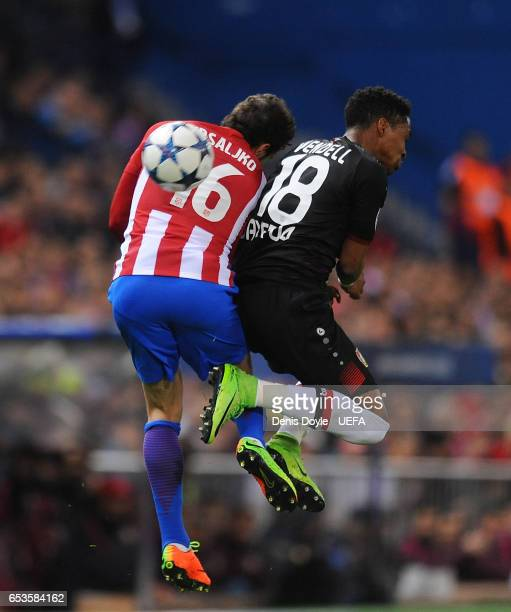 Sime Vrsaljko of Club Atletico de Madrid battles with Wendell of Bayer Leverkusen during of the UEFA Champions League Round of 16 second leg match...