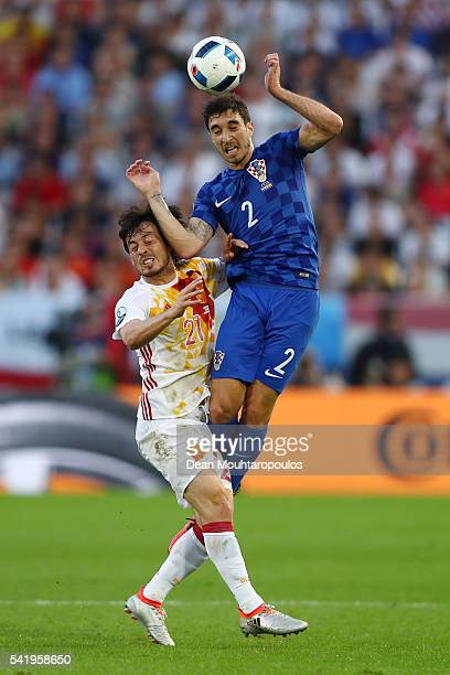 Sime Vrsaljko of Croatia and David Silva of Spain compete for the ball during the UEFA EURO 2016 Group D match between Croatia and Spain at Stade...