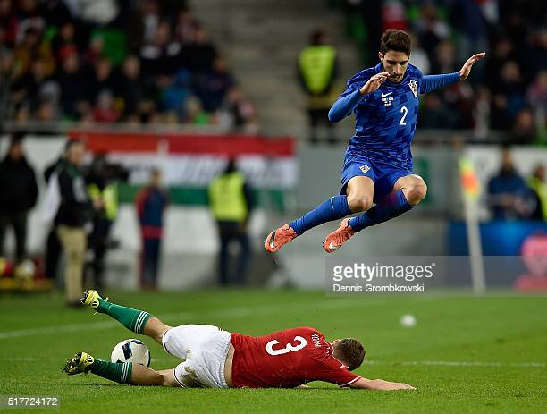 Sime Vrsaljko of Croatia is challenged by Mihaly Korhut of Hungary during the International Friendly match between Hungary and Croatia at Groupama...