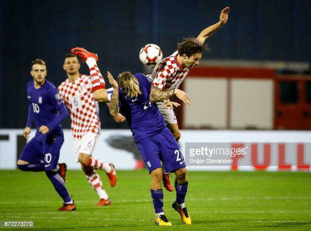 Sime Vrsaljko of Croatia jumps for the ball over Kostas Stafylidis of Greece during the FIFA 2018 World Cup Qualifier PlayOff First Leg between...