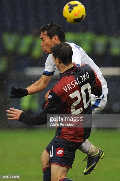 Sime Vrsaljko of Genoa CFC clashes with Yuto Nagatomo of FC Internazionale Milano during the Serie A match between Genoa CFC and FC Internazionale...