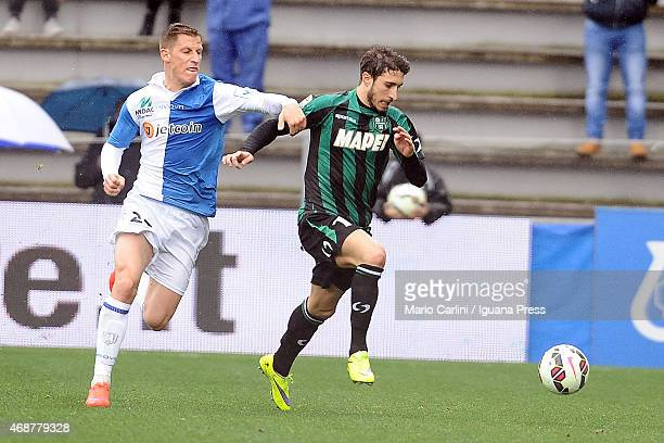 Sime Vrsaljko of US Sassuolo Calcio competes the ball with Valter Birsa of AC Chievo Verona during the Serie A match between US Sassuolo Calcio and...