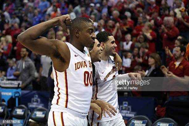 Simeon Carter Jordan Ashton and Georges Niang of the Iowa State Cyclones celebrate after defeating the Arkansas Little Rock Trojans with a score of...