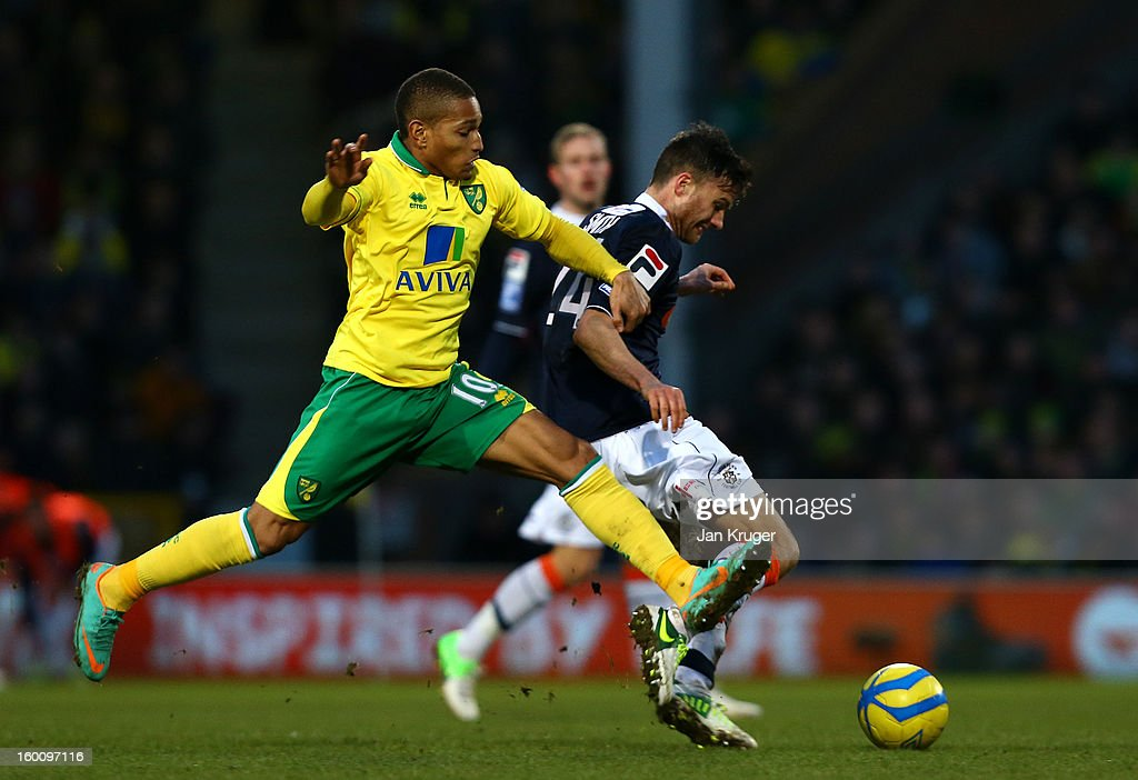 Simeon Jackson of Norwich City battles with Jonathan Smith of Luton Town during the FA Cup with Budweiser fourth round match between Norwich City and Luton Town at Carrow Road on January 26, 2013 in Norwich, England.