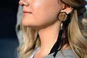 Simge Ozgoren poses wearing an earring by Mango during Mercedes Benz Fashion Week Istanbul FW15 on March 19 2015 in Istanbul Turkey