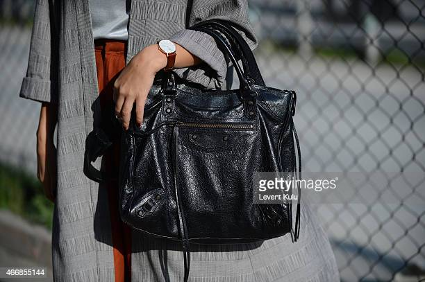 Simge Ozgoren poses wearing hand bag by Balenciaga and watch by Daniel Wellington during Mercedes Benz Fashion Week Istanbul FW15 on March 19 2015 in...