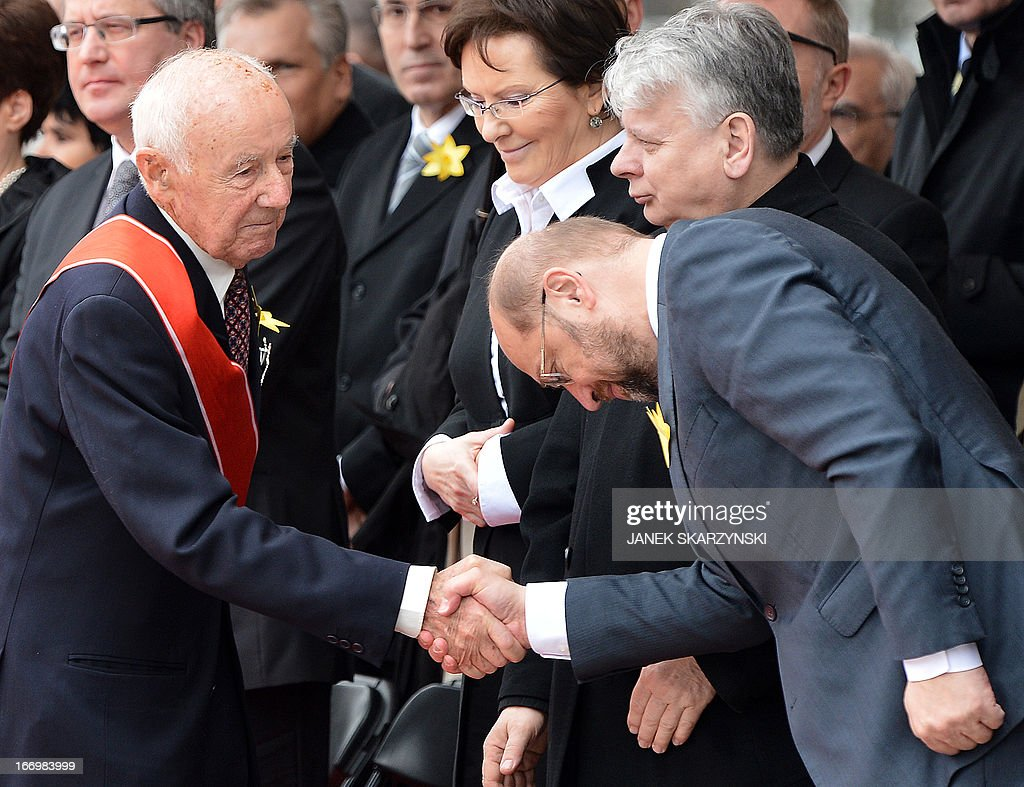 Simha 'Kazik' Rotem (L), one of the last living Warsaw Ghetto insurgents shakes hands with President of European Parliament Martin Schulz in front of the Warsaw Ghetto Uprising monument, during the ceremonies held 70 years to the day of the ghetto uprising against the Nazi Germany in Warsaw on April 19, 2013. SKARZYNSKI