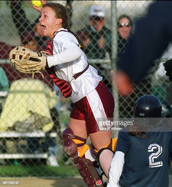Simi High catcher Christina Haddad pops up with the ball in her glove after tagging out Chaminade High baserunner Holly Lampert in the bottom of the...