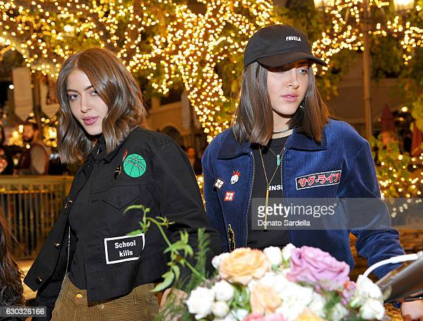 Simi Khadra and Haze Khadra of SIMIHAZE attends the opening of Laduree at The Grove in Los Angeles hosted by Rick Caruso and Jessica Alba in...