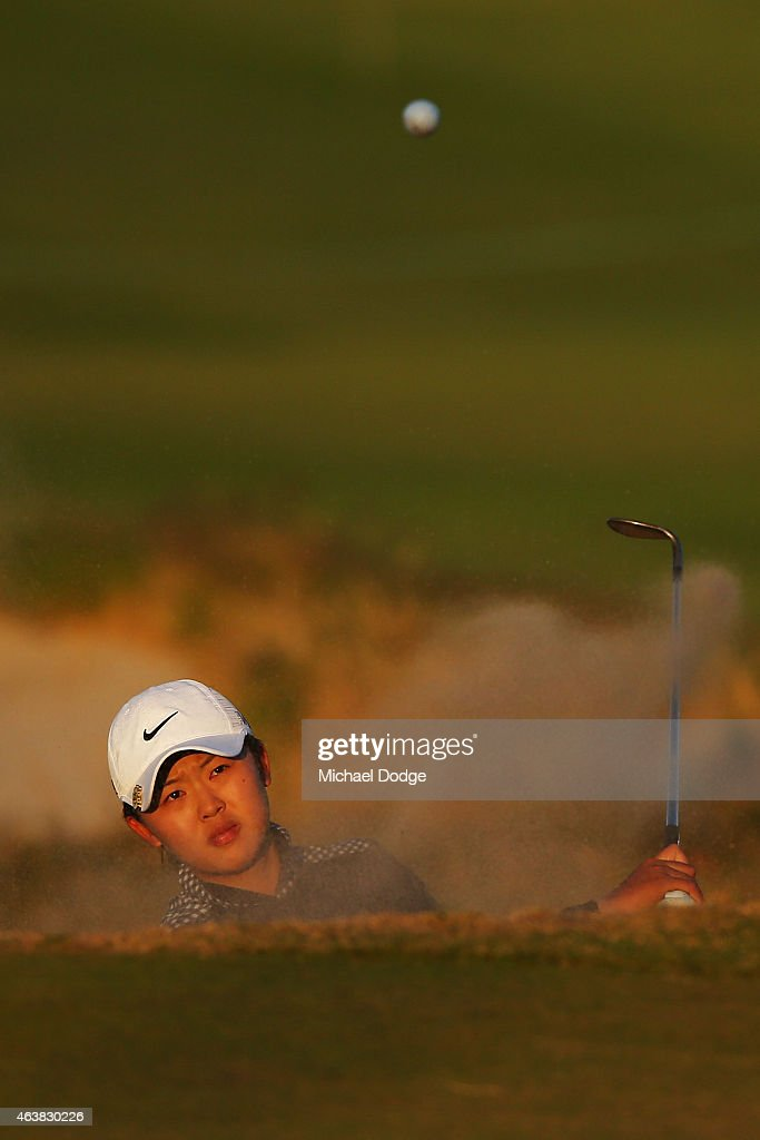 Simin Feng of China hits an approach shot on the 18th hole during day one of the LPGA Australian Open at Royal Melbourne Golf Course on February 19, 2015 in Melbourne, Australia.