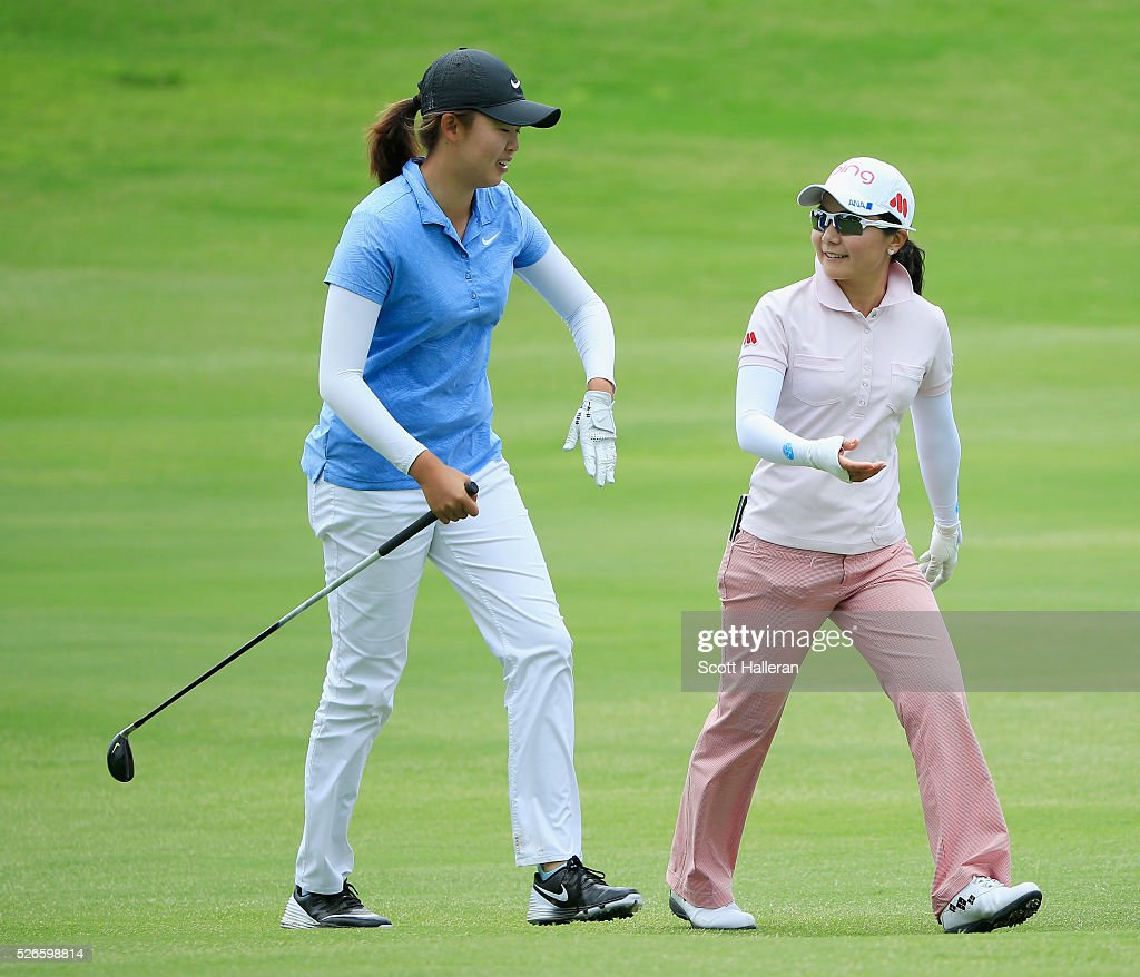 Simin Feng of China (L) walks alongside <a gi-track='captionPersonalityLinkClicked' href=/galleries/search?phrase=Ayako+Uehara+-+Golf&family=editorial&specificpeople=4690711 ng-click='$event.stopPropagation()'>Ayako Uehara</a> of Japan on the seventh hole during the third round of the Volunteers of America Texas Shootout at Las Colinas Country Club on April 30, 2016 in Irving, Texas.