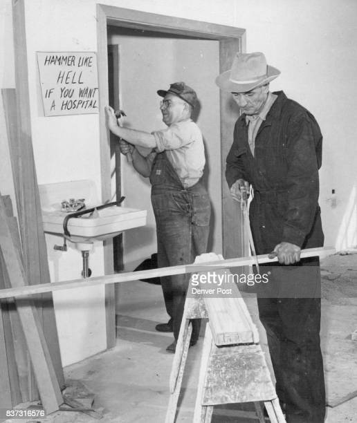 Simla's Mayor Dempsey Pfost saws while the Rev Edward Ness hammers to speed the day when they will have a hospital Credit Denver Post