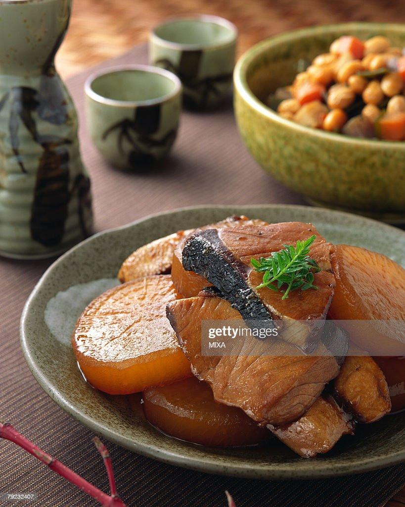Simmered amberjack with Japanese radish : Stock Photo