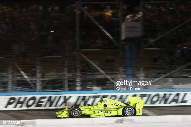 Simmon Pagenaud of France driver of the Team Penske Chevrolet takes the checkered flag to win the Desert Diamond West Valley Phoenix Grand Prix at...