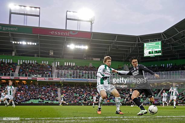 Simmon Tibbling of FC Groningen Steven Berghuis of AZ during the Dutch Eredivisie match between FC Groningen and AZ Alkmaar at Euroborg on February 8...