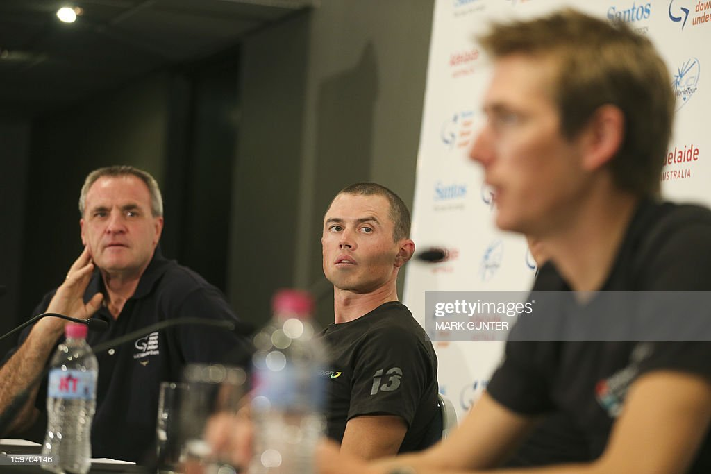 Simnon Gerrans (C) from Australia looks on as Andy Schleck (R) from Luxemburg talks at a press conference prior to the Tour Down Under in Adelaide, on January 19, 2013. The Tour Down Under runs from 20-27 January 2013. IMAGE STRICTLY RESTRICTED TO EDITORIAL USE - STRICTLY NO COMMERCIAL USE AFP PHOTO / Mark Gunter