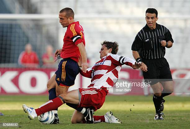 Simo Valakari of FC Dallas tackles Jason Kreis of Real Salt Lake in the first half on April 23 2005 in Dallas Texas FC Dallas won 30