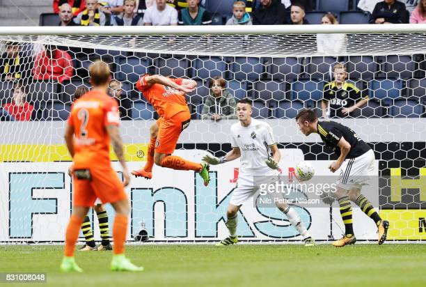 Simon Alexandersson of Athletic FC Eskilstuna shoots a header during the Allsvenskan match between AIK and Athletic FC Eskilstura at Friends arena on...