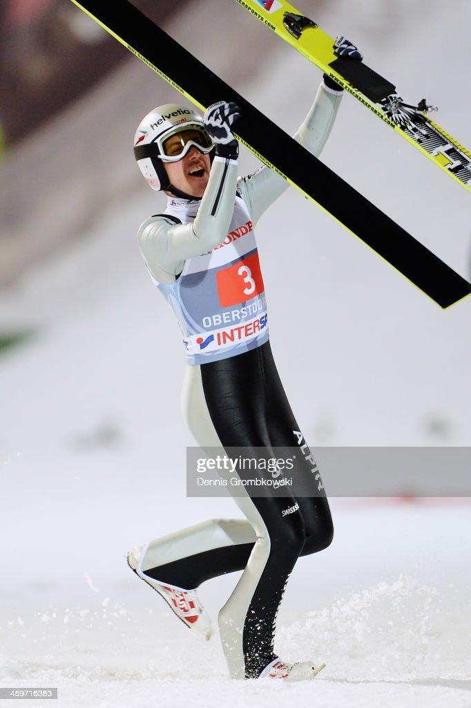 Simon Amman of Switzerland celebrates after winning the Four Hills Tournament Ski Jumping event at SchattenbergSchanze on December 29 2013 in...
