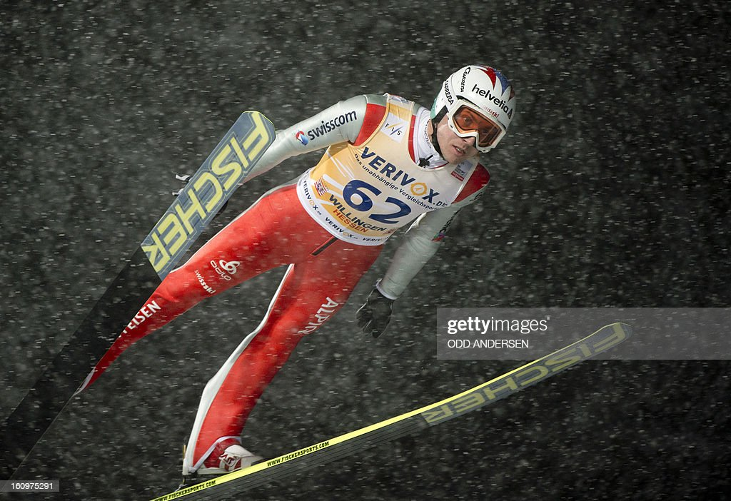 Simon Amman of Switzerland jumps during the qualifying run at the FIS Ski Jumping World Cup on the Muehlenkopfschanze hill in Willingen, western Germany on February 8, 2013. Heavy snowfall made the conditions challenging for the athletes.