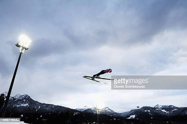 Simon Amman of Switzerland soars through the air during the final round on day 2 of the Four Hills Tournament Ski Jumping event at...