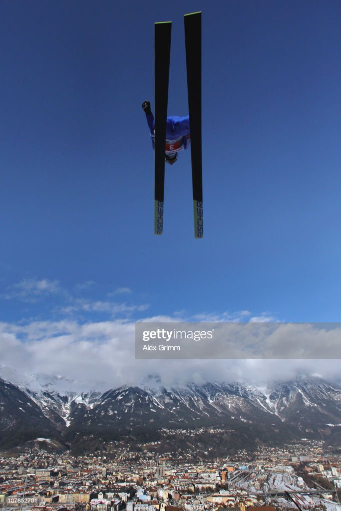 Simon Ammann of Switezrland competes during the trial round for the FIS Ski Jumping World Cup event of the 59th Four Hills ski jumping tournament at...