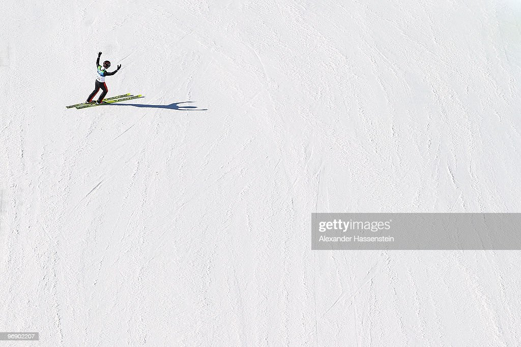 Simon Ammann of Switzerland celebrates after coming to a landing after jumping the Large Hill on day 9 of the 2010 Vancouver Winter Olympics at Ski...