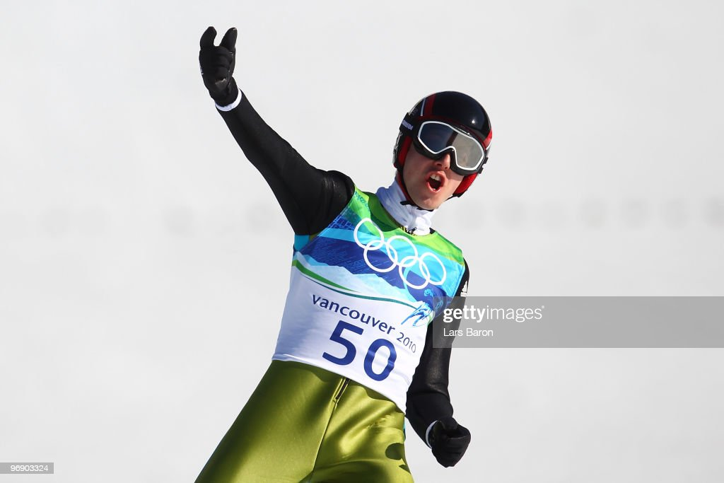 Simon Ammann of Switzerland celebrates after coming to a landing after the final jump the Large Hill on day 9 of the 2010 Vancouver Winter Olympics at Ski Jumping Stadium on February 20, 2010 in Whistler, Canada.
