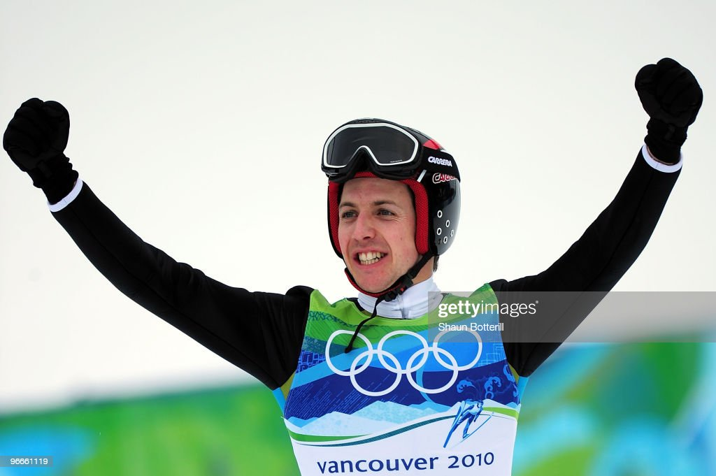 Simon Ammann of Switzerland celebrates after he won Gold in the Ski Jumping Normal Hill Individual event on day 2 of the Vancouver 2010 Winter...