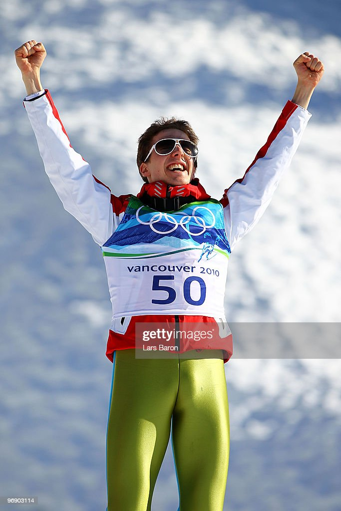 Simon Ammann of Switzerland celebrates his Gold medal after the final jump the Large Hill on day 9 of the 2010 Vancouver Winter Olympics at Ski...