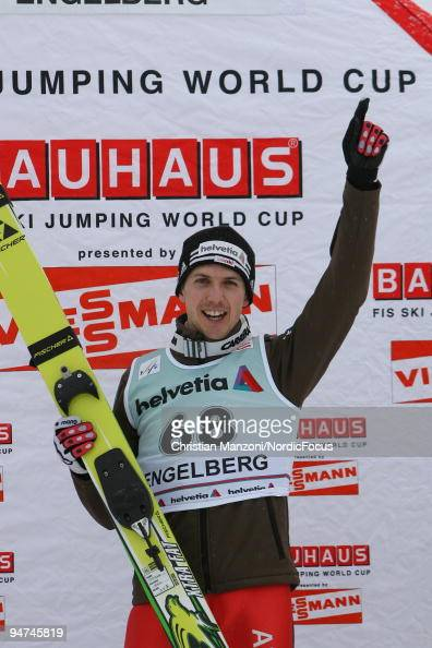 Simon Ammann of Switzerland celebrates his victory during the flower ceremony after the Individual Large Hill competition of the FIS Ski Jumping...