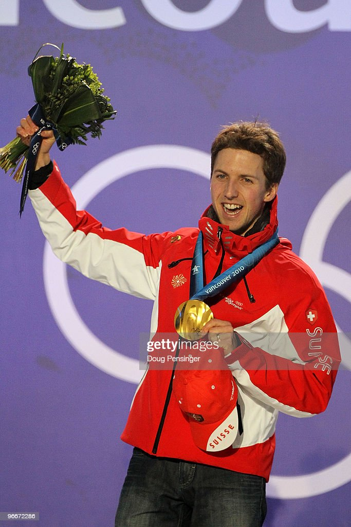 <a gi-track='captionPersonalityLinkClicked' href=/galleries/search?phrase=Simon+Ammann&family=editorial&specificpeople=210667 ng-click='$event.stopPropagation()'>Simon Ammann</a> of Switzerland celebrates with his gold medal during the Medal Ceremony for the Ski Jumping Normal Hill Individual on day 2 of the Vancouver 2010 Winter Olympics at Whistler Medals Plaza on February 13, 2010 in Whistler, Canada.