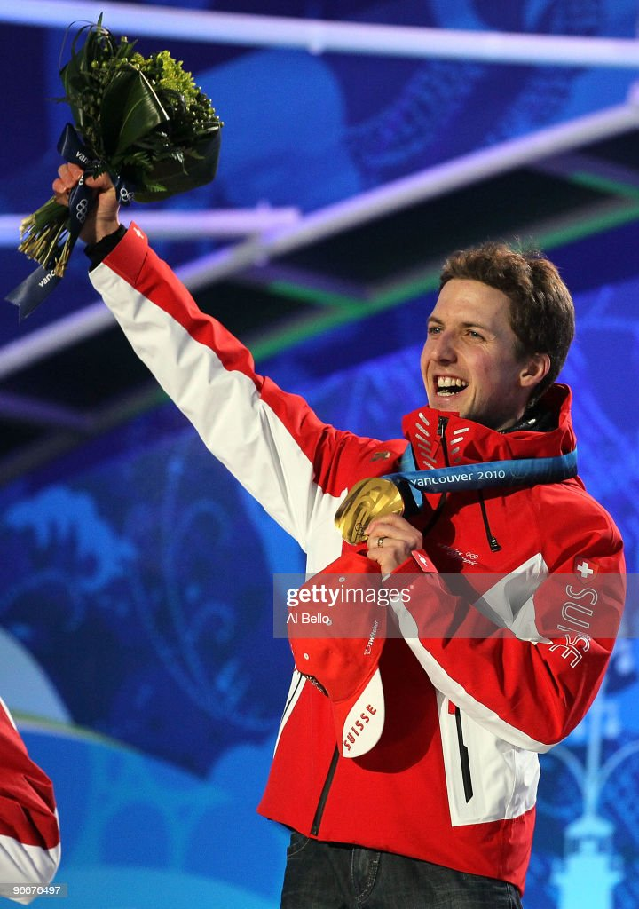 Simon Ammann of Switzerland celebrates with his gold medal during the Medal Ceremony for the Ski Jumping Normal Hill Individual on day 2 of the Vancouver 2010 Winter Olympics at Whistler Medals Plaza on February 13, 2010 in Whistler, Canada.