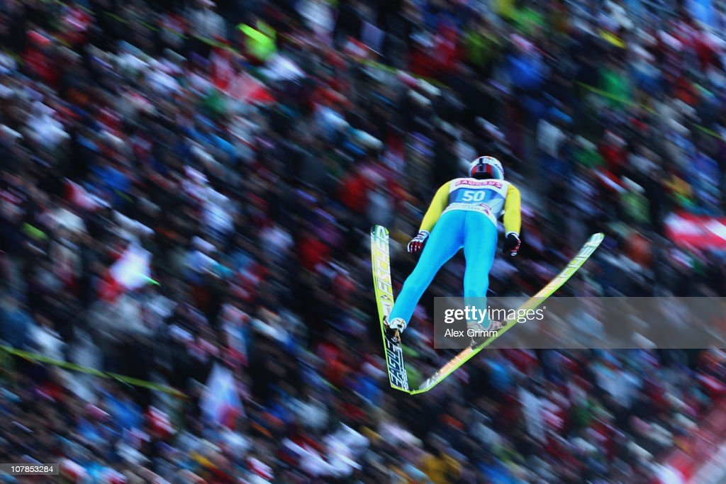 Simon Ammann of Switzerland competes during the first round for the FIS Ski Jumping World Cup event of the 59th Four Hills ski jumping tournament at...