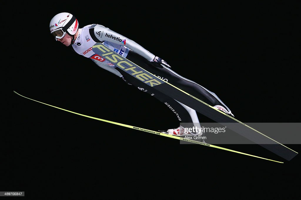 Simon Ammann of Switzerland competes during the first round on day 2 of the Four Hills Tournament Ski Jumping event at Schattenberg-Schanze on December 29, 2013 in Oberstdorf, Germany.