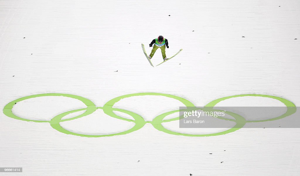 Simon Ammann of Switzerland competes during the Ski Jumping Normal Hill Individual 1st Round on day 2 of the Vancouver 2010 Winter Olympics at...