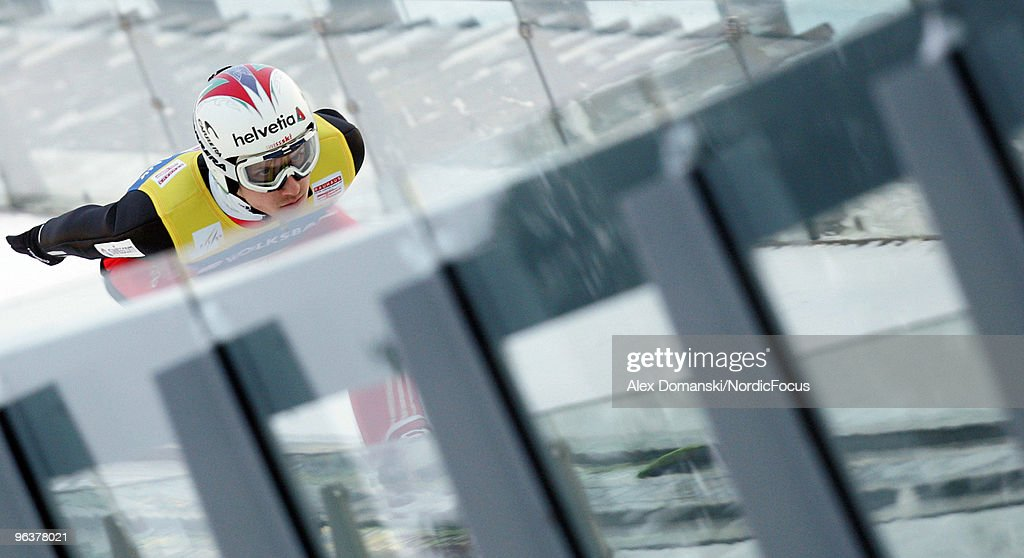 Simon Ammann of Switzerland competes during the trial round of the FIS Ski Jumping World Cup on February 3, 2010 in Klingenthal, Germany.